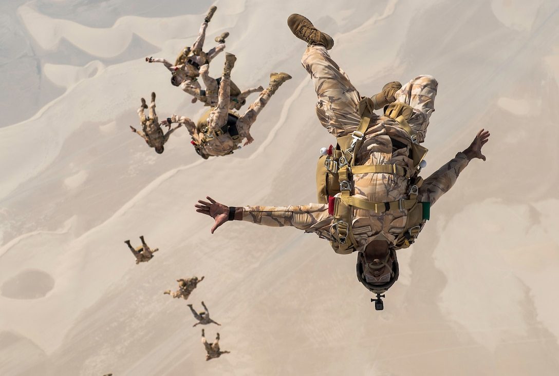 Qatari special operations personnel conduct a military free-fall Friendship Jump over Qatar on Aug. 21, 2017. In support of continued partnerships between the U.S. and Qatar, special forces from the two nations participated in a static-line and military free-fall parachute training exercise. This marked the first event of its kind conducted between the U.S. and Qatar, allowing the enhanced interoperability between special forces from both nations. (U.S. Air Force photo by Staff Sgt. Trevor T. McBride)