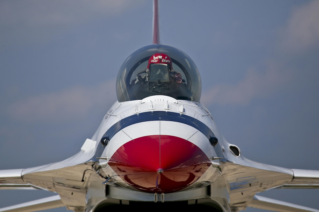 "U.S. Air Force Maj. Whit Collins, the Opposing Solo Pilot for the U.S. Air Force Air Demonstration Squadron ""Thunderbirds,"" prepares his aircraft for a practice flight at Air National Guard Base Atlantic City, N.J., Aug. 22, 2017. The Thunderbirds are in town performing at the Thunder Over the Boardwalk Air Show in Atlantic City, N.J. (U.S. Air National Guard photo by Master Sgt. Matt Hecht/Released)"