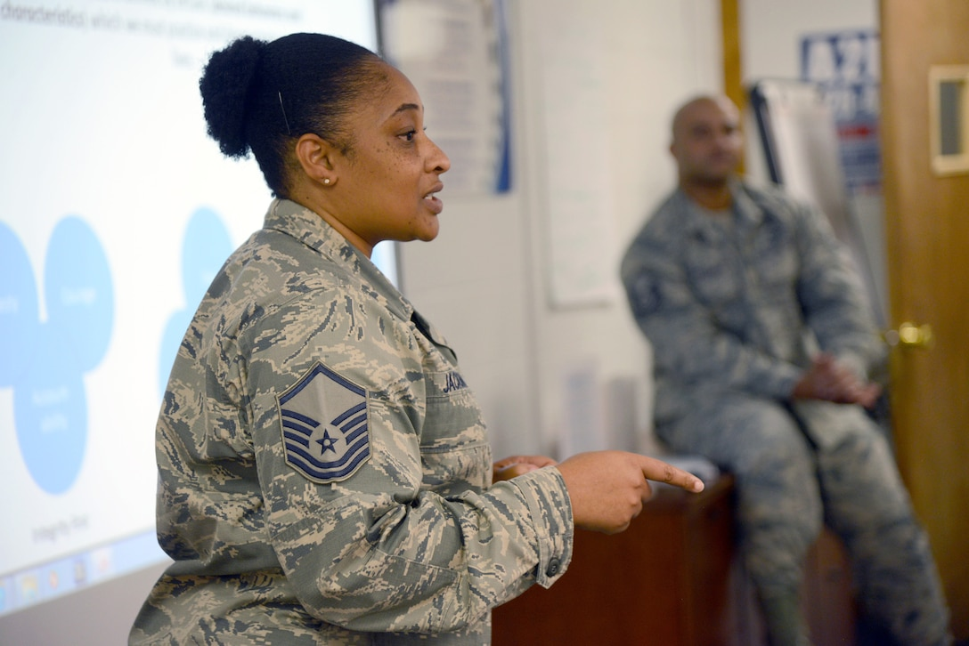 """Master Sgt. Debbie Jackson, a 552nd Air Control Wing Career Assistance Advisor (as of Oct. 2017) at Tinker's First Term Airman Course, leads a discussion about """"TLC""""-Trust, Loyalty and Commitment-with the Airmen in FTAC's most recent class."""