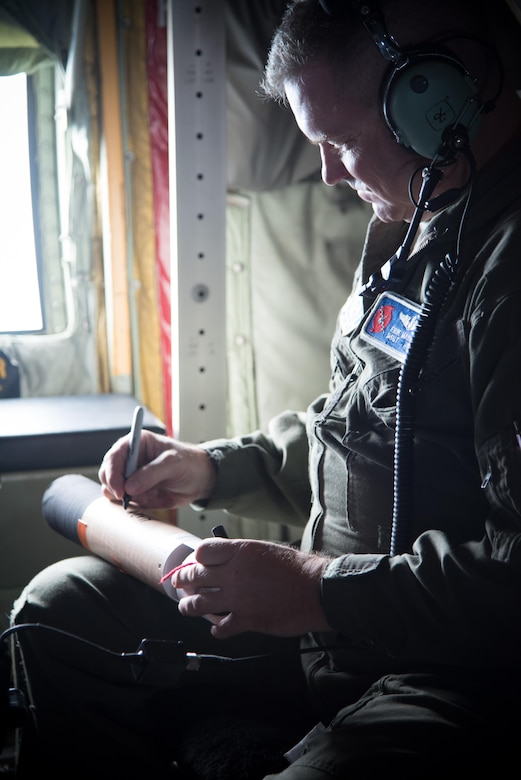 Master Sgt. Erik Marcus, 53rd Weather Reconnaissance Squadron loadmaster, prepares a dropsonde during a flight into Hurricane Harvey Aug. 24, 2017 out of Keesler Air Force Base, Mississippi. (U.S. Air Force photo/Staff Sgt. Heather Heiney)