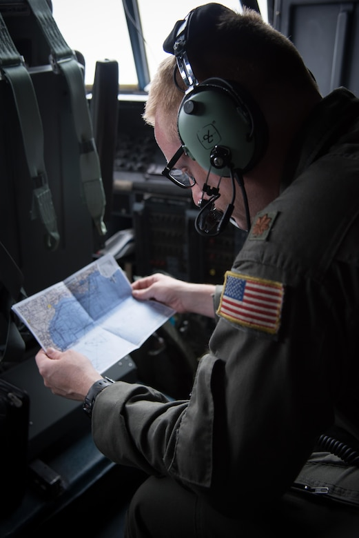 Maj. Grant Wagner, 53rd Weather Reconnaissance Squadron navigator, reviews a map of the Gulf of Mexico during a flight into Hurricane Harvey Aug. 24, 2017 out of Keesler Air Force Base, Mississippi. (U.S. Air Force photo/Staff Sgt. Heather Heiney)