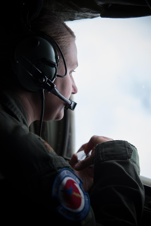 Maj. Kimberly Spusta, 53rd Weather Reconnaissance Squadron aerial reconnaissance weather officer, collects weather data for the National Hurricane Center during a flight into Hurricane Harvey Aug. 24, 2017 out of Keesler Air Force Base, Mississippi. (U.S. Air Force photo/Staff Sgt. Heather Heiney)