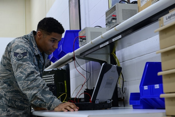 U.S. Air Force Senior Airman Christian Anthony, an electrical and environmental specialist assigned to the 509th Maintenance Squadron, reads the next step of a technical order (TO) before moving forward at Whiteman Air Force Base, Mo., Aug. 3, 2017.