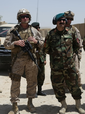 U.S. Marine Brig. Gen. Roger Turner, the commanding general of Task Force Southwest, and Brig. Gen. Wali Mohammed Ahmadzai, the commanding general of 215th Corps, await CH-47 Chinooks during Operation Maiwand Five near Nawa, Afghanistan, Aug., 21, 2017. Several advisors with the Task Force are assisting their Afghan counterparts throughout the operation, which is designed to clear insurgents from the Nawa district in Helmand province and help promote security and stability in the region. (U.S. Marine Corps photo by Cpl. Tyler Harrison)
