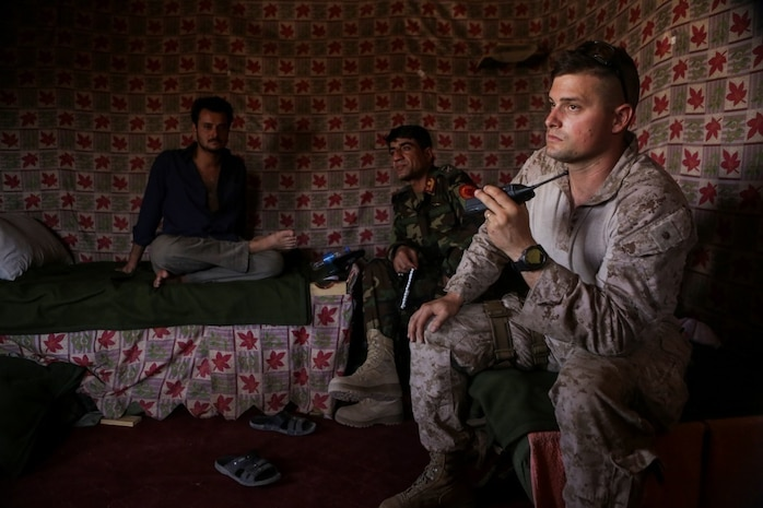 U.S. Marine Maj. Sean Kaiser, a communications advisor with Task Force Southwest, helps track troop movements with Afghan National Army soldiers from 215th Corps during Operation Maiwand Five near Nawa, Afghanistan, Aug. 19, 2017. Various elements of the Afghan National Defense and Security Forces, including the ANA, Afghan National Police and Afghan Border Police are clearing the Nawa area of enemy presence with assistance from Task Force advisors. (U.S. Marine Corps photo by Cpl. Tyler Harrison)
