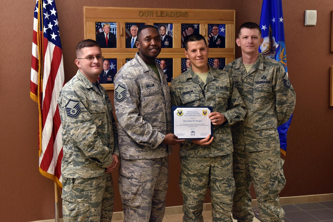 U.S. Air Force Staff Sgt. Joshua Peloquin, a network administrator supervisor assigned to the 509th Communications Squadron, is presented with the Top III MVP Award at Whiteman Air Force Base (AFB), Mo., Aug. 18, 2017.