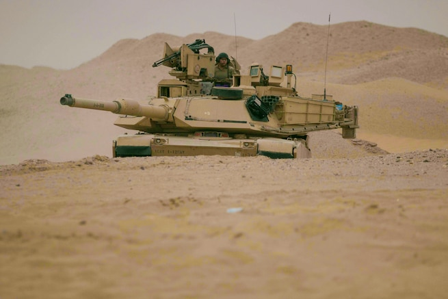 An M1A2 Abrams Main Battle Tank assigned to Alpha Company, 1st Battalion, 12th Cavalry Regiment, 3rd Armored Brigade Combat Team, 1st Cavalry Division maneuvers to the final objective during the company's situational training exercise July 15, 2017. The STX was used to validate the unit through mission essential tasks to sustain the readiness of the combined arms battalions.  (U.S. Army photo by Staff Sgt. Leah R. Kilpatrick)