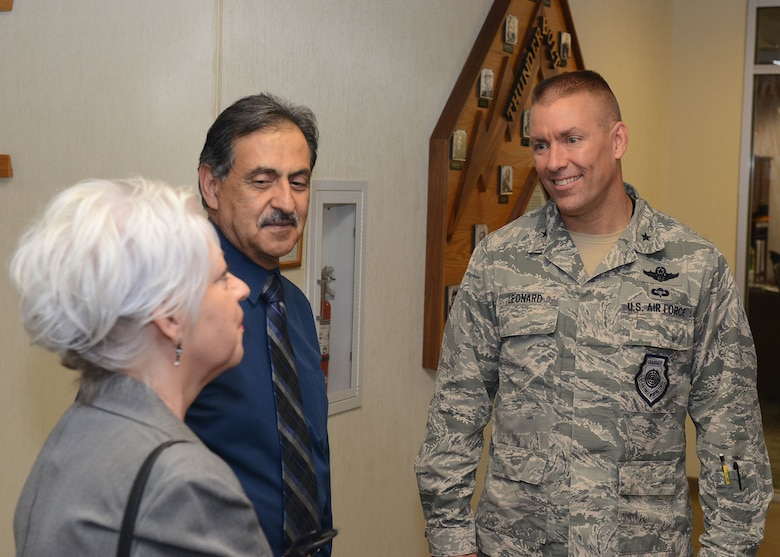 Brig. Gen. Brook Leonard, 56th Fighter Wing commander, talks with Sherry and Nick Fresques at Luke Air Force Base, Ariz., Aug. 18, 2017. The Fresques son Capt. Jeremy Fresques, 23rd Special Tactics Squadron special tactics officer, was killed in action in Iraq in 2005. The Fresques have become the first gold star family at Luke to apply for the Defense Biometric Identification System Card initiative allowing them access to the base and Airman and Family Readiness Center resources. (U.S. Air Force photo/Senior Airman James Hensley)