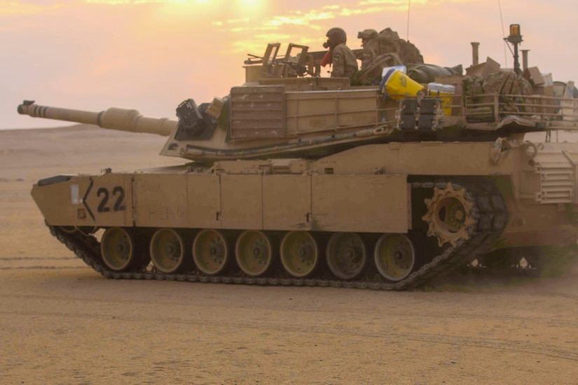 An M1A2 Main Battle Tank assigned to Bravo Company, 3rd Battalion, 8th Cavalry Regiment, 3rd Armored Brigade Combat Team, 1st Cavalry Division maneuvers toward the after-action review site after conducting an early morning area defense at Udairi Range Complex during the company's situational training exercise Aug. 12, 2017. The STX was used to validate the unit through mission essential tasks to sustain the readiness of the combined arms battalions.   (U.S. Army photo by Staff Sgt. Leah R. Kilpatrick)