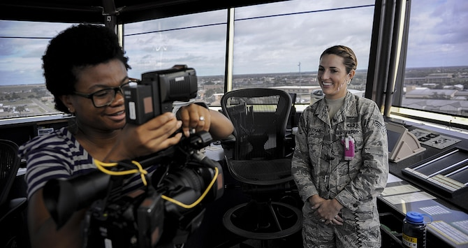 Blessing Woksman, KAMR Local 4 News media reporter, sets up for an interview with Senior Airman Jillian Moorman, 27th Special Operations Support Squadron air traffic controller, at Cannon Air Force Base, N.M., Aug. 21, 2017. Woksman set up the interview to learn more about what air traffic control does. (U.S. Air Force photo by Airman First Class Vernon R. Walter III)
