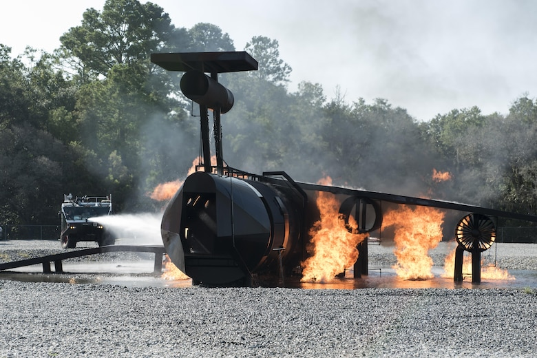 Firefighters from the 23d Civil Engineer Squadron douse flames during live fire training at Moody Air Force Base, Ga., Aug. 24, 2017. This training is an annual requirement for Moody firefighters and is just one of the ways they stay ready to protect people, property and the environment from fires and disasters. (U.S. Air Force photo by Staff Sgt. Olivia Dominique)