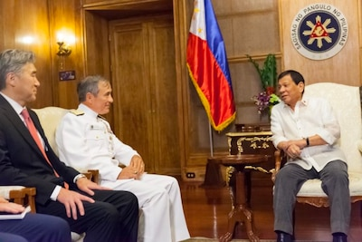 U.S. Ambassador to the Philippines Sung Y. Kim;  Navy Adm. Harry B. Harris Jr., commander of U.S. Pacific Command; and Philippine President Rodrigo R. Duterte meet in Malacañan Palace in Manila.