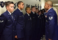 "U.S. Air Force Staff Sgt. Bryan Robinson, the First Term Airmen Course (FTAC) NCO in charge, conducts a uniform inspection at Whiteman Air Force Base, Mo., Aug. 7, 2017. Airmen begin the course with a full service dress blues uniform inspection before starting the ""Enhancing Human Capital"" part of the professionalism training. (U.S. Air Force photo/Staff Sgt. Danielle Quilla)"