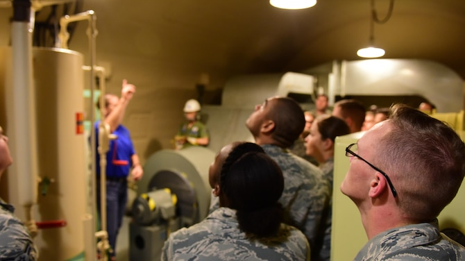 David Grisdale, the director of historical property assigned to the 509th Bomb Wing, shows First Term Airmen Course Airmen a section of the Oscar-1 Minuteman Missile Alert Facility at Whiteman Air Force Base, Mo., Aug. 10, 2017. The tour was to help the Airmen understand Whiteman's history and involvement during the Cold War.