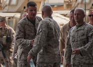U.S. 5TH FLEET AREA OF OPERATIONS (Aug. 17, 2017) U.S. Marine Lt. Gen. William D. Beydler, commanding general of Marine Forces Central Command (MARCENT), greets with Marines of Marine Wing Support Squadron (MWSS), All-Weather Fighter Attack Squadron (VMFA) 224 and Deployed Joint Command and Control (DJC2). Lt. Gen. Beydler and Sgt. Maj. William T. Thurber, MARCENT Sergeant Major, visited the Marines to address evolving topics in the future of the Marine Corps. (Photo by Mass Communication Specialist 3rd Class Alex J. Cole)