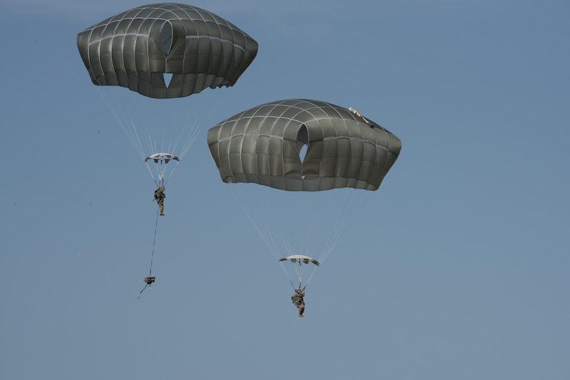 Soldiers with Headquarters and Headquarters Battery, 2nd Battalion, 319th Field Artillery Regiment, perform a combat equipment airborne jump with the new Joint Effects Targeting System -- JETS -- during operational testing at Fort Bragg, N.C., June 15, 2017. Once on the ground, soldiers test the system to ensure it still functions. Army photo