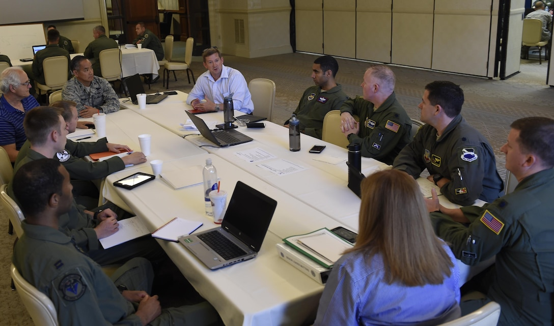 Lt. Col. Langdon Root, Aircrew Crisis Task Force Summit lead, conducts a briefing Aug. 15 during a two-week aircrew retention summit here as part of a holistic approach to improve readiness and capacity by increasing retention of experienced aviators.