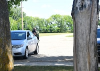 A U.S. Customs and Border Protection agent takes cover behind a vehicle in the parking lot behind Carl Ben Eielson Elementary School during an active-shooter scenario Aug. 10, 2017, on Grand Forks Air Force Base, N.D. The USCBP led the three-day training event, providing classroom and hands-on training dealing with a variety of active-shooter scenarios.  (U.S. Air Force photo by Airman 1st Class Elora J. Martinez)