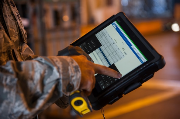 Staff Sgt. Philip Beasley, 735th Air Mobility Squadron assistant air freight shift supervisor, performs cargo inventory using a new digital program at Joint Base Pearl Harbor-Hickam, Hawaii, Aug. 24, 2017.