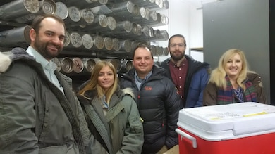 The Cold Regions Research and Engineering Laboratory hosted a group of peers for a tour of the facilities and to discuss research collaborations. Geotechnical and Structures Laboratory visitors included Charlie Burchfield, Dr. Stephanie Wood, Dr. Robert Moser, Dr. Jay Shannon and Dr. Paige Buchanan. All are shown in a cold room at minus 5 degrees Fahrenheit, posed in front of a rack of ice cores that were drilled and retrieved from Greenland and Antarctica during the past 50 years. The visit was hosted by Dr. Emily Asenath-Smith and the CRREL Materials Team. CRREL and GSL are part of the U.S. Army Engineer Research and Development Center.