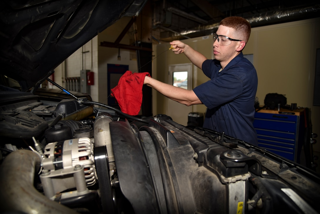 U.S. Air Force Senior Airman Luis Cintron, a vehicle maintenance technician assigned to the 6th Logistics Readiness Squadron, checks the oil level during a preventative maintenance procedure at MacDill Air Force Base, Fla., Aug. 17, 2017.