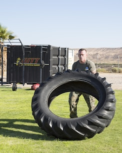 Gunnery Sgt. Justing Kratzer, radio and maintenance chief, flips a tractor tire as part of his High Intensity Tactical Training (HITT) at Sorensen Field aboard Marine Corps Logistics Base Barstow, Calif. Aug. 18.