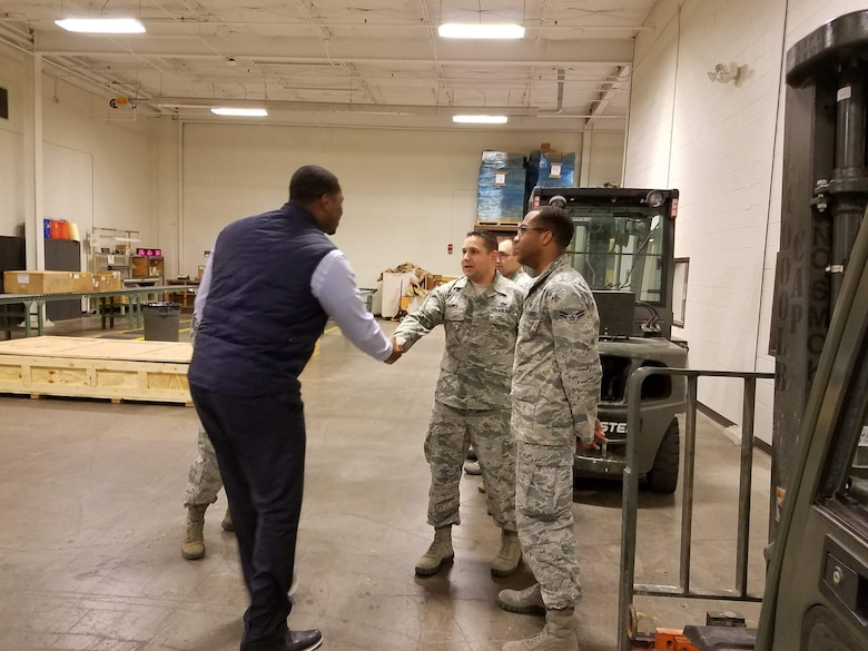 Juston White, 22nd Logistics Readiness Squadron honorary commander, meets with Airmen during an immersion tour, Nov. 17, 2016, at McConnell Air Force Base, Kan. White frequently brings youths from the Boys & Girls Club to McConnell in order to educate them on the services and responsibilities of the Airmen working here. (Courtesy photo)