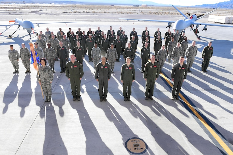 Members of the 867th Attack Squadron stand at attention for a group photo on Dec. 15, 2016, at Creech Air Force Base, Nev.