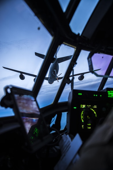 A KC-135 Stratotanker prepares to refuel an MC-130J Commando II during an aerial refueling mission over New Mexico on Aug. 23, 2017. The in-air refueling allows the MC-130J to carry its mission into harsher environments to support hostile infiltration. (U.S. Air Force photo by Staff Sgt. Charles Dickens/Released)