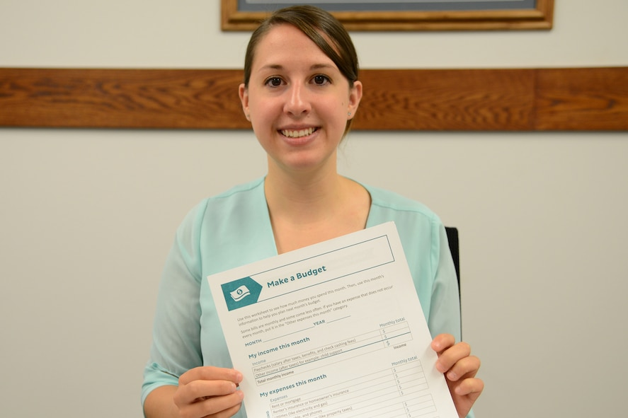 Rebecca Burbach, Malmstrom personal financial counselor, displays one of many budget resource tools available for customers Aug. 21, 2017, at Malmstrom Air Force Base, Mont. The Airmen and Family Readiness Center can assist Airmen and their families with budget planning and money management. (U.S. Air Force photo/Staff Sgt. Delia Martinez)