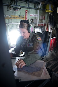 Air Force Maj. Kimberly Spusta, 53rd Weather Reconnaissance Squadron aerial reconnaissance weather officer, collects weather data for the National Hurricane Center during a flight into Hurricane Harvey out of Keesler Air Force Base, Miss., Aug. 24, 2017. Air Force photo by Staff Sgt. Heather Heiney