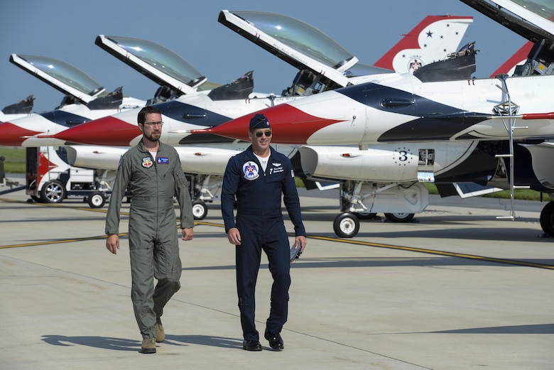Andrew Jackson (left), radio host for 88.7 The Bridge, and Lt. Col. Kevin Walsh, U.S.A.F. Thunderbirds operations officer, walk to the No. 7 jet for a media flight Aug. 25, 2017, during the Thunder Over Dover Open House Family Day at Dover Air Force Base, Del. The Thunderbirds have performed for millions of fans since 1953, and are scheduled to complete nearly 70 performances this year. (U.S. Air Force photo by Staff Sgt. Aaron J. Jenne)