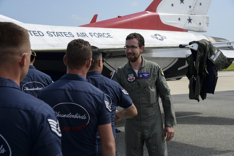 Andrew Jackson, radio host for 88.7 The Bridge, shakes hands with members of the U.S.A.F. Thunderbirds after a media flight Aug. 25, 2017, during the Thunder Over Dover Open House at Dover Air Force Base, Del. Jackson said he was extremely grateful for the experience and thanked the Thunderbirds for their service and professionalism. (U.S. Air Force photo by Staff Sgt. Aaron J. Jenne)