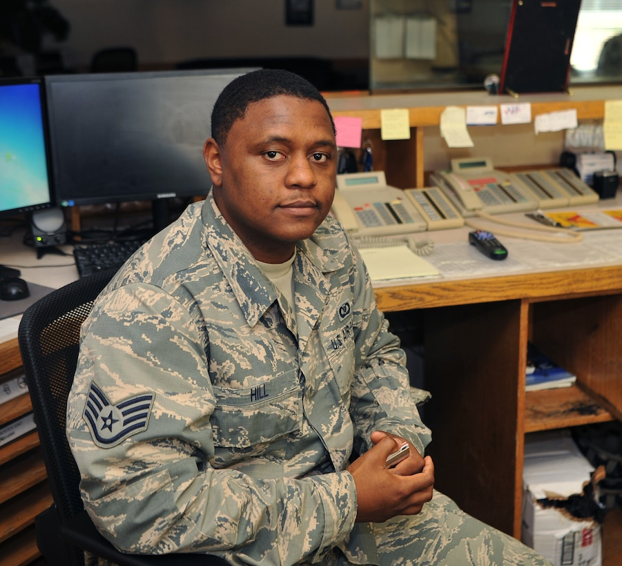 Staff Sgt. Michael Hill, 9th Operations Support Squadron airfield management operations supervisor, poses for a photo