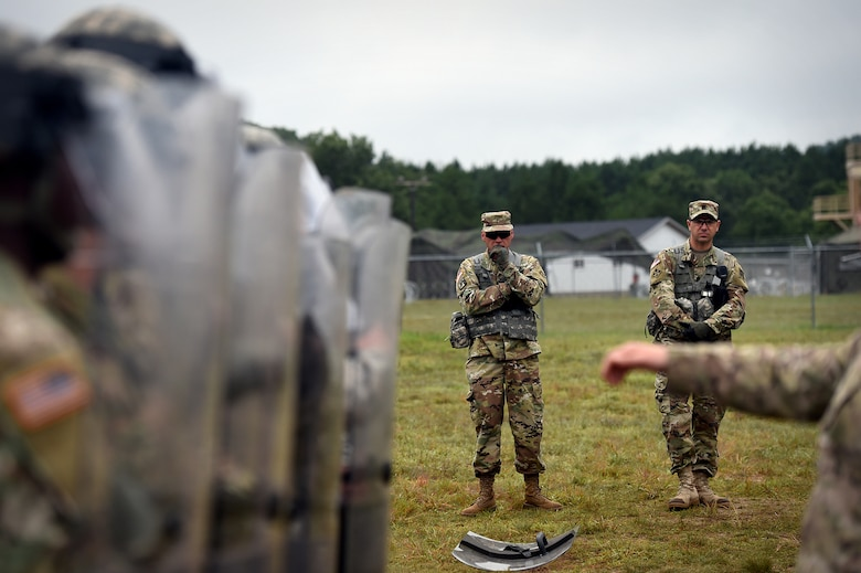Army Reserve Chief Warrant Officer 5 Eric Nordy, left, Command Chief Warrant Officer, 85th Support Command, with 1st Sgt. Jason Hoffman, first sergeant of Headquarters and Headquarters Company, 181st Multi-functional Training Brigade, observe military police riot control training at a mock detention facility during Combat Support Training Exercise 86-17-02 at Fort McCoy, Wisconsin, from August 5 – 25, 2017.