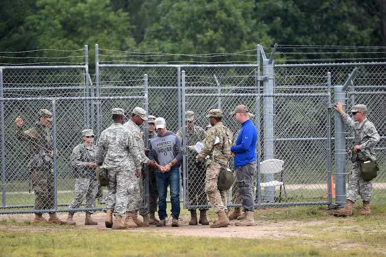 Army Reserve Military Police in-process a detainee at an entry control point in a mock detention facility during Combat Support Training Exercise 86-17-02 at Fort McCoy, Wisconsin, from August 5 – 25, 2017.