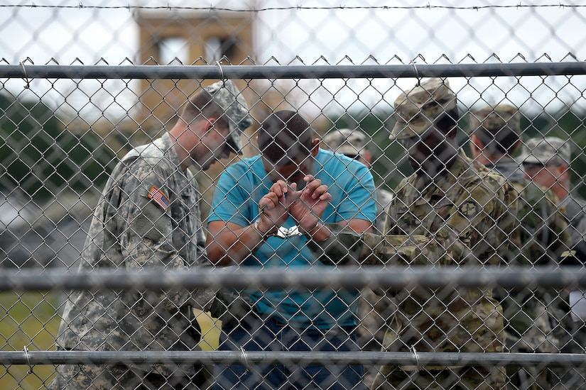 Army Reserve Military Police search a detainee at an entry control point in a mock detention facility during Combat Support Training Exercise 86-17-02 at Fort McCoy, Wisconsin, from August 5 – 25, 2017.