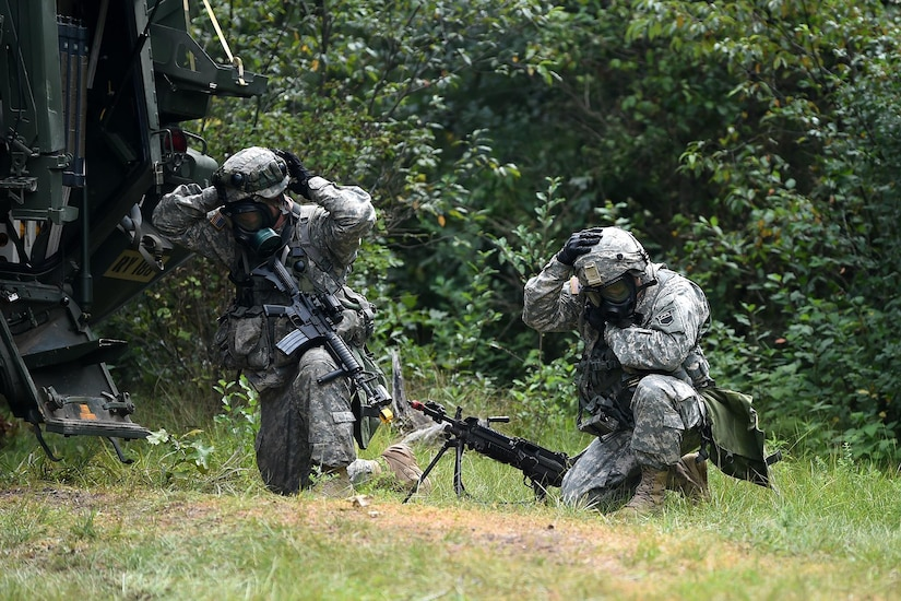 Army Reserve Soldiers don their protective mask during a simulated chemical attack outside of their perimeter at Combat Support Training Exercise 86-17-02 at Fort McCoy, Wisconsin, from August 5 – 25, 2017.