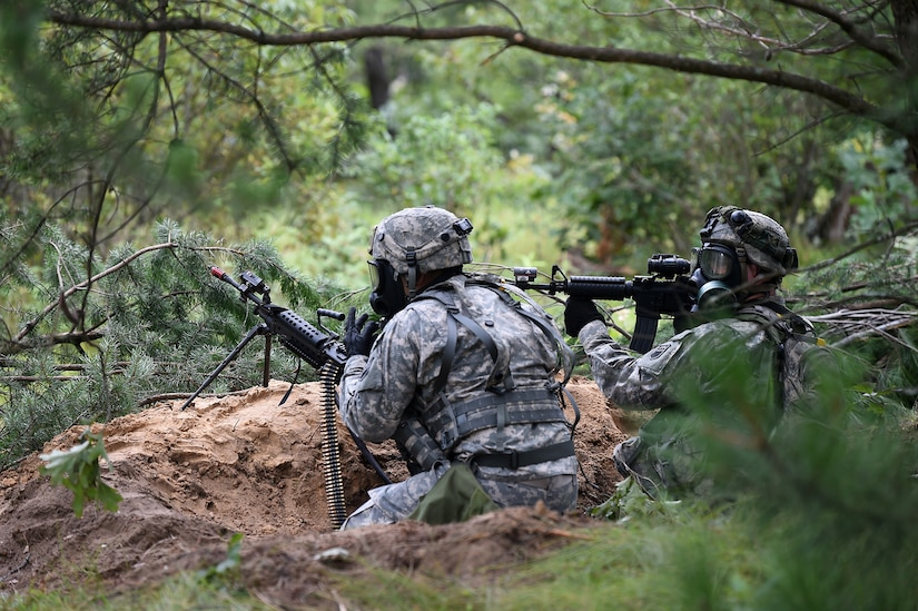 Army Reserve Soldiers move into their fighting positions during a simulated artillery and chemical attack outside of their perimeter at Combat Support Training Exercise 86-17-02 at Fort McCoy, Wisconsin, from August 5 – 25, 2017.