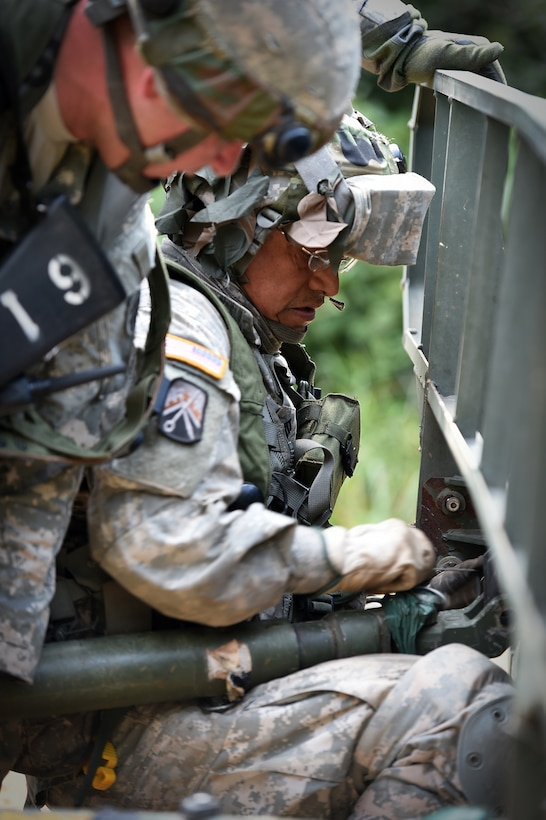 Army Reserve Staff Sgt. Byron Molina, assigned to the 693rd Quartermaster Company, Bell, California, secures a pin from a tow bar to a disabled humvee following an attack during Combat Support Training Exercise 86-17-02 at Fort McCoy, Wisconsin, from August 5 – 25, 2017.