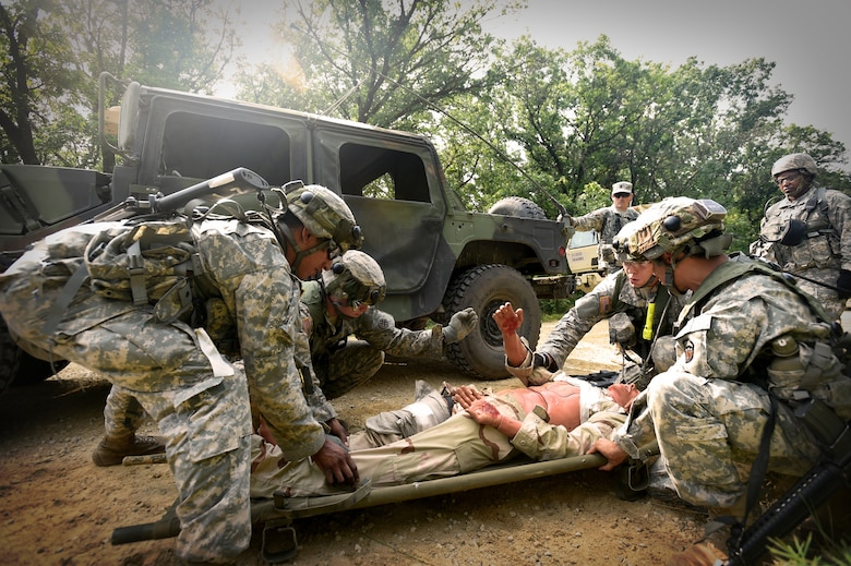 Army Reserve Soldiers, assigned to the 693rd Quartermaster Company, Bell, California, prepare to conduct a litter evacuation following an attack during Combat Support Training Exercise 86-17-02 at Fort McCoy, Wisconsin, from August 5 – 25, 2017.