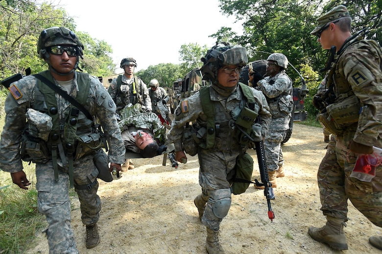 Army Reserve Soldiers, assigned to the 693rd Quartermaster Company, Bell, California, evacuate a casualty after an attack on their convoy during Combat Support Training Exercise 86-17-02 at Fort McCoy, Wisconsin, from August 5 – 25, 2017.