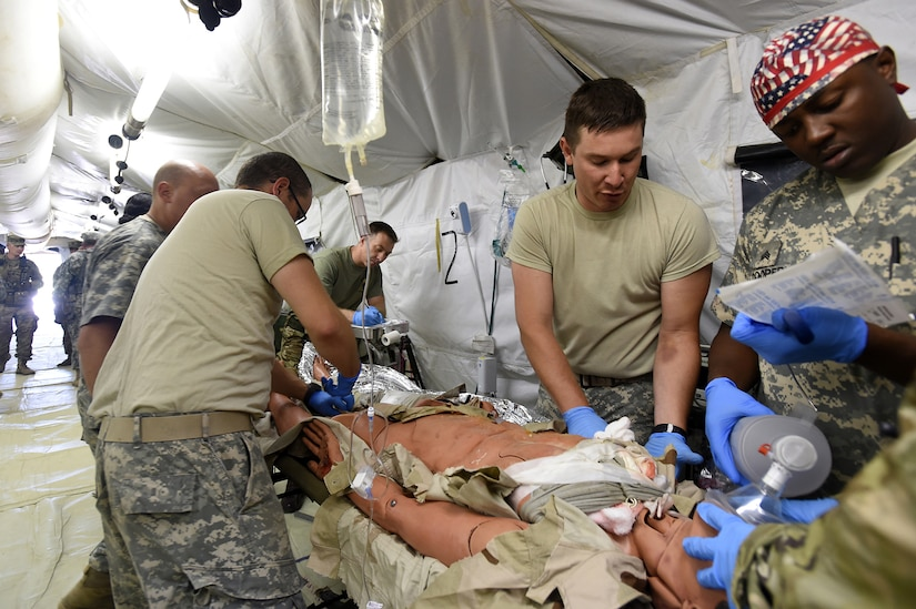 Army Reserve Soldiers, assigned to the 256th Combat Support Hospital, Twinsburg, Ohio, triage a mock trauma patient ambushed in an attack during Combat Support Training Exercise 86-17-02 at Fort McCoy, Wisconsin, from August 5 – 25, 2017.