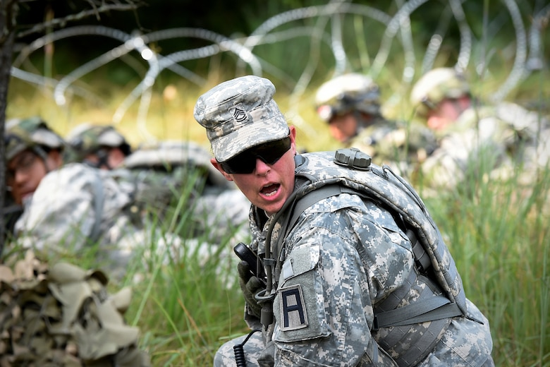 Army Reserve Sgt. 1st Class Miranda Herrmann, observer coach/trainer from the 2nd Battalion, 361st Training Support Regiment, 181st Multi-functional Training Brigade, yells out to Soldiers, from her training unit, during a base attack at Combat Support Training Exercise 86-17-02 at Fort McCoy, Wisconsin, from August 5 – 25, 2017.