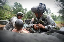 Army Reserve Soldiers, assigned to the 693rd Quartermaster Company, Bell, California, treat a casualty during a base attack at Combat Support Training Exercise 86-17-02 at Fort McCoy, Wisconsin, from August 5 – 25, 2017.