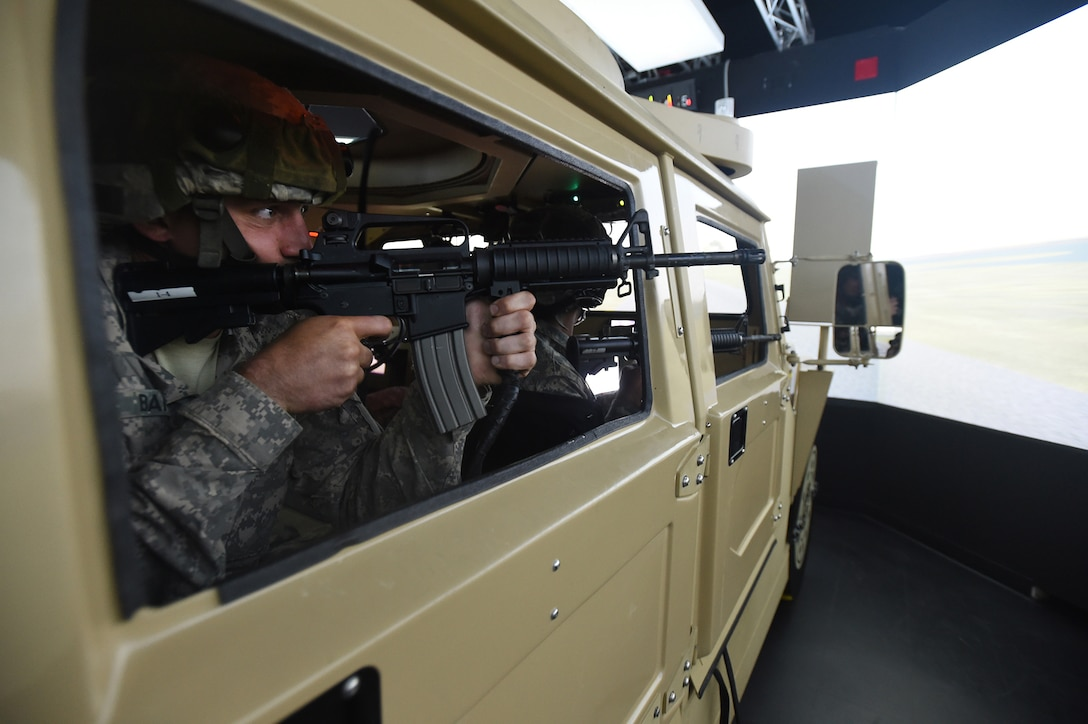 Army Reserve Spc. Andrew Bahun, from the 454th Transportation Company, Columbus, Ohio, engages targets during a high value target extraction in a Reconfigurable Vehicle Tactical Trainer 360-degree immersion simulator at Combat Support Training Exercise 86-17-02 at Fort McCoy, Wisconsin, from August 5 – 25, 2017.