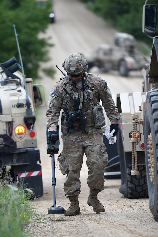 U.S. Air Force explosive ordnance disposal Tech. Sgt. Antonio Medrano from the 349th Civil Engineer Squadron, Travis Air Force Base, conducts a post-blast analysis, to collect evidence, after a simulated explosively formed projectile hit their convoy during a joint mission at Combat Support Training Exercise 86-17-02 at Fort McCoy, Wisconsin, from August 5 – 25, 2017.