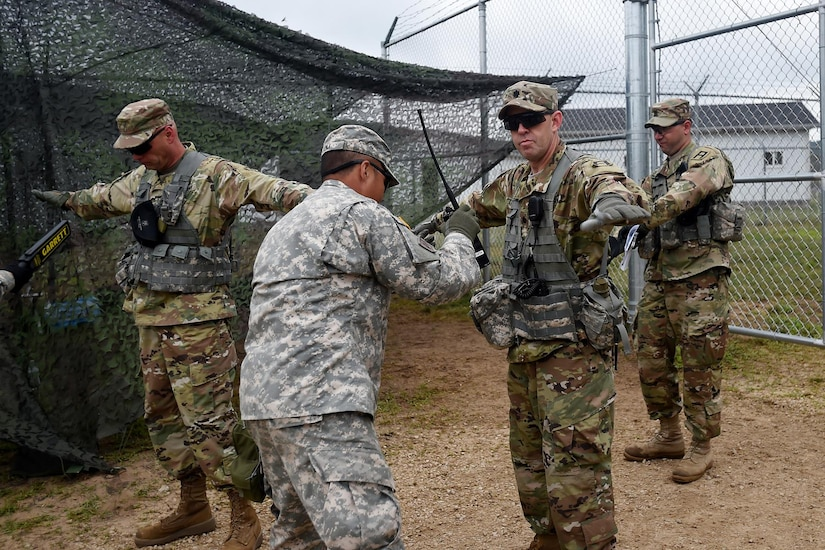 Army Reserve Sgt. David Kim, assigned to the 822nd Military Police Company, Arlington Heights, Illinois, conducts a pat-down search at an entry control point in a mock detention facility during Combat Support Training Exercise 86-17-02 at Fort McCoy, Wisconsin, from August 5 – 25, 2017.