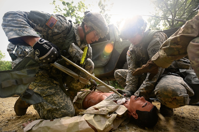 Army Reserve Soldiers assigned to the 693rd Quartermaster Company, Bell, California, treat a casualty after an ambush during Combat Support Training Exercise 86-17-02 at Fort McCoy, Wisconsin, from August 5 – 25, 2017.