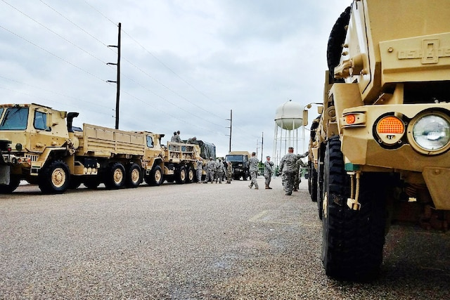 A group of Guardsmen prepare vehicles in Austin.